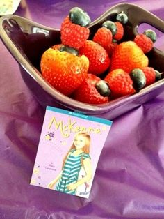 Our American Girl McKenna Gymnastics birthday party featured fresh fruit and healthy snacks, complete with paper cut-outs of McKenna's book