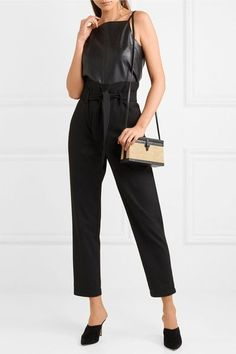 NANUSHKA Jude belted twill slim-leg pants $340 Nanushka's twill pants are cut in a slim-leg silhouette and slightly cropped. This 'Jude' pair sits at the smallest part of your waist, so be sure to maximize the flattering shape by knotting the tie and tucking in your top or shirt.  Shown here with: Nanushka Top, Hunting Season Shoulder bag, Paul Andrew Mules, Annie Costello Brown Earrings.