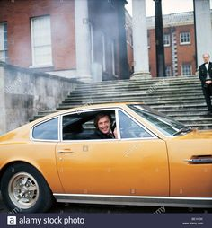 Download this stock image: PERSUADERS  - UK 70s TV series with Roger Moore as Brett Sinclair in the Aston Martin DBS with V8 wheels and markings - BE1HDK from Alamy's library of millions of high resolution stock photos, illustrations and vectors.