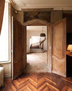 Rustic herringbone wood plank flooring