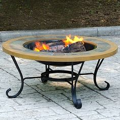 Uniflame Slate Tile - Faux Wood Outdoor Firebowl.  This Blue Rhino outdoor wood burning firepit is a functional and affordable addition to any deck, patio or pool side. It features a handcrafted slate tile and faux wood mantle for a traditional and elegant feel. Also included is the insert cover which instantly converts from a firepit to a table, perfect for entertaining. #firepit #firebowl #table