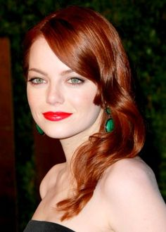 Actress Emma Stone looks absolutely stunning with her fiery red auburn locks worn in loose waves. This coppery hue is bold and sexy, and we love how it brings out Emma's gorgeous green eyes. For a dramatic and long lasting shine, ask your stylist for a glossing wash after your color treatment.