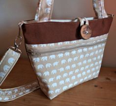 Brown and white zip fastening elephant print messenger/shoulder bag with contrasting. by bagsofloveliness on Etsy