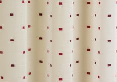 Linen-look ivory voile with Sloane Red Eyelet Curtains, scattered red squares and a red faux-silk deep header, eyelet heading suitable for rods and poles.