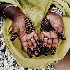 CRAFTED | Gorée, Senegal: Using tape as the resist, Senegalese women use black henna to create bold, geometric designs on their hands and feet. Strikingly different than the brown, intricate floral henna designs of India, but equally unique and beautiful.  #crafted #goree #senegal #henna #beauty #women #blackhenna #brownhenna #geometric #resistdye #floral #intricate #India #fashion #design #style #image: #MarinaRicou.