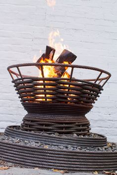 Fire Bowls made from metal cable. This is beyond my DIY abilities - no welding skills. But I like the idea very much.