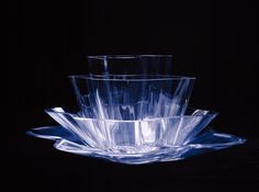 Aino and Alvar Aalto designed the Aalto Flower together. It is a set of four different, free-form dishes: a shallow dish, two bowls and a vase. Stacked together, they create a beautiful, sculpturesque glass flower. Absolut Vodka, Art Of Glass, Alvar Aalto, Nordic Design, Three Dimensional, Finland, Shot Glass, Nostalgia, Foundation