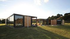 Alex and Corban Walls part-own this holiday home, Mini Whananaki. Garage Design, Exterior Design, Ideal Garage Doors, The Block Nz, Glass Light Fixtures, Three Bedroom House, Minimal Home, House Goals, Simple House