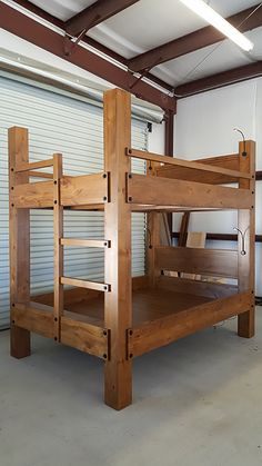 tall queen over queen bunk bed with optional headboards and goose neck reading lights with USB ports for charging phones, tablets and MP3 players.