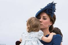 The Duchess was spotted planting a kiss on her daughter's head, pictured, after the family departed their 10-hour flight