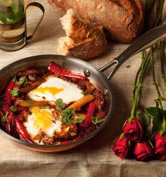Shakshuka by Yotam Ottolenghi. An Israeli and North African breakfast dish. I think I'd some paprika to the dish too.