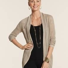 Black slack, a black top and a sweater can be a little more stylish with some small additions of jewelry.