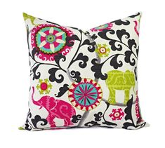 Two decorative pillow covers in a gorgeous hot pink and green print with elephants. These elephant pillow covers fit any size pillow insert