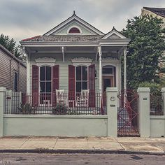 """This Victorian on Governor Nicholls Street is atypical for the French Quarter not only for its asymmetrical façade but also because it is set back from the banquette with a walled """"front yard"""". 