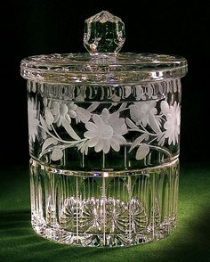 An exquisite cut floral pattern, lovely fluting and scalloped rim adorn this pristine hand cut biscuit jar. Lid has faceted ball top and scalloped rim. Antique Glassware, Crystal Glassware, Waterford Crystal, Cut Glass, Glass Art, Clear Glass, 3d Laser, Vintage Cookies, Crystal Gifts