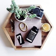 tray with succulent, candle, bottle opener, and camera