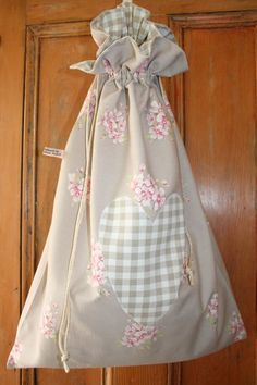 Everything in your home has a place, even the dirty laundry in this pretty handmade floral laundry bag complete with an appliqued heart.