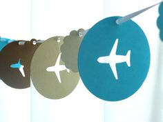 Airplane garland. Think different colors.....>>>>TELL YOUR FRIENDS that we'd love to see them at our aviation themed restaurant, The Left Seat West, in Glendale, Arizona!! Check out our décor at: http://www.facebook.com/pages/Left-Seat-West-Restaurant/192309664138462