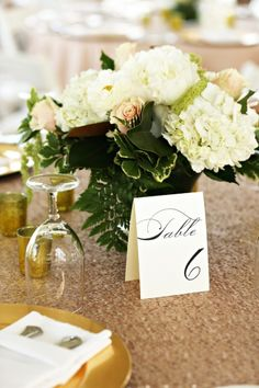 Sequined table linens are best when paired with elegant table numbers. | Lindsay Colette