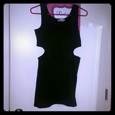 Black mini dress Cutouts on both sides on the waist. Short and sexy black dress.  Never worn Dresses Mini