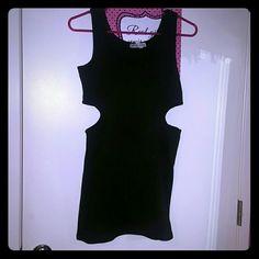 Black mini dress Cutouts on both sides on the waist. Short and sexy black dress.  Never worn Dresses Mini