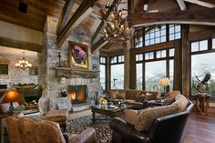 Great room with high ceilings, stone fireplace, lots of windows