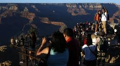 Newsela | Grand Canyon's views could be altered by development - Visitors take in the view of the Grand Canyon at Mather Point on the Southern Rim in January 2014. The town of Tusayan, Arizona, has proposed adding commercial development near the canyon that is being fought by the National Park Service. Photo: Mel Melson/Los Angeles Times/MCT