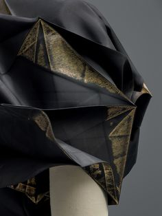 Miyake Design Studio (Japanese, founded 1970), Issey Miyake (Japanese, born 1938). 132 5. ISSEY MIYAKE No. 1 Ensemble(detail), autumn/winter 2010–11, Prêt–à–Porter. Custom software–rendered pattern, heat–pressed on black recycled–polyethylene terephthalate (PET)–bottle plain weave, heat–stamped with gold metallic foil. Photo © Nicholas Alan Cope. #ManusxMachina #CostumeInstitute