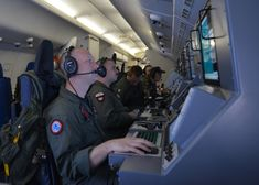 US Navy crew members on a P-8A Poseidon assist search-and-rescue operations for Malaysia Airlines flight MH370 in the Indian Ocean, March 16, 2014.