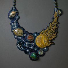 Our Space | Celestial NightOur Space, necklace Planet: Earth, Moon, Mars, Saturn, Uranus, and Sun. Constellations: Ursa Major and Ursa Minor. As well as meteorites:) Maker unidentified. Toho seed beads, cabochons - calcite, chrysocolla, agate, sengilit, labradorite, nacre, wire, beads.