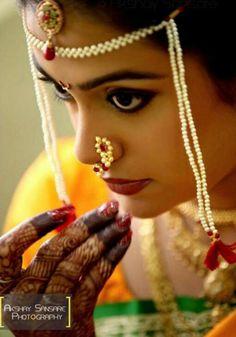 Traditional Indian Maharashtrian bride wearing bridal silk saree, jewellery and hairstyle. Nath. Nose pin. Hindu bride. Indian Bridal Makeup. Indian Bridal Fashion.
