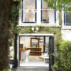 Mews house:Love the connection of inside and out,lush green planting surrounding ornate period features. Interior Architecture, Interior And Exterior, Interior Design, Residential Architecture, Living Pool, City Living, Mews House, Outdoor Spaces, Outdoor Decor