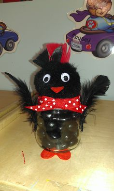 Even though its not easter...  Baby food jar, feathers, google eyes, jelly beans, orange felt, ribbon and 2'' craft ball. chirp chirp