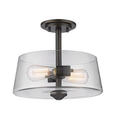 Harmony of vintage style fixture, clear glass, and vintage bulb shapes define the Annora family. Clear glass paired with olde bronze fittings complete the look. Number of Light: 2 Lights Bulb Wattage: