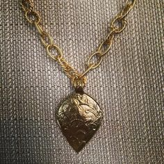 La Femme Necklace - Vintage gold pendant accented with a chunky satin Hamilton multi link necklace. $56.00
