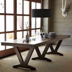This could be a cool table for our kitchen, although it is dark brown not black.