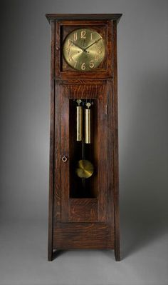 Stickley often used the hand-lettered font used in the numerals of this 1902 tall clock