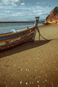 Old row boat on an empty beach.