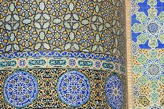 """Floral & geometric patterns of  restored Timurid tile mosaics decorate a wall in the courtyard of the Friday Mosque or """"Masjid-i Jami"""", the largest mosque in Herat, dating to 1200 AD, Herat, Afghanistan.  Much of the Ghorid and Timurid decorations on the"""