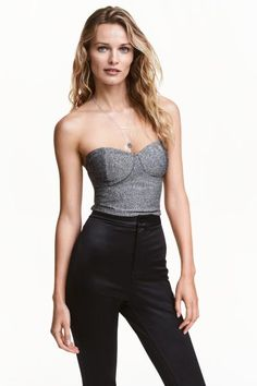 Glittery bustier: Strapless bustier in viscose-blend jersey containing glittery threads with shaped cups and a visible zip at the back. Jersey lining.