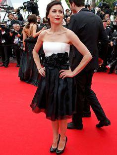 Olivia Ruiz  A cantora usou um vestido preto e branco, com detalhe em apliques na cintura. Reuters - Agência Reuters