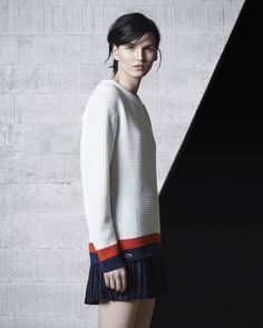 LACOSTE A waffled knit sweater pairs up with a tennis-style pleated skirt for an iconic and contemporary style.