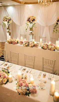 © 2009 Simply Beautiful Decor - I love the drapery behind, elegant yet so simple!: