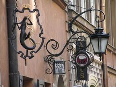 Shop signs, Old Town, Warsaw, Poland
