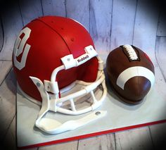 OU helmet and football.