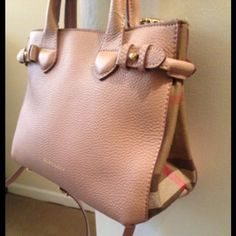 Burberry Leather Tote Bag Gorgeous Burberry Leather Tote With Canvas Check Print on Sides.  Great condition, like new!  There is writing in a discrete area under the zipper of the inside pocket (see pic).  The longer strap is removable.  Darling bag! Burberry Bags