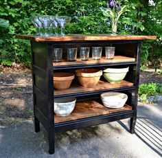 antique solid oak 19th century dresser turned kitchen island in black with pine shelves.