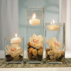 "Floating candle centerpieces. I want something like this for my ""beach"" wedding. Simple, beautiful, and cheap!"