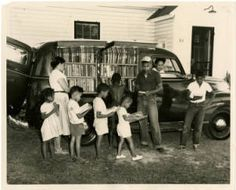 African-American children line up outside of Albemarle Region bookmobile, Northampton County, NC :: NC State Library History Collection