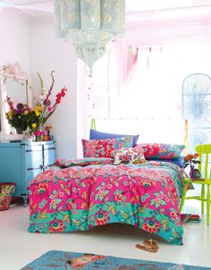 This is a happy room. Love the lantern, color scheme, blue dresser, pastel mirror, and just everything.